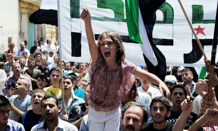 A Syrian girl chants slogans during a demonstration in Idlib, Syria, in this citizen journalism image provided by the Local Coordination Committees in Syria and accessed Friday.