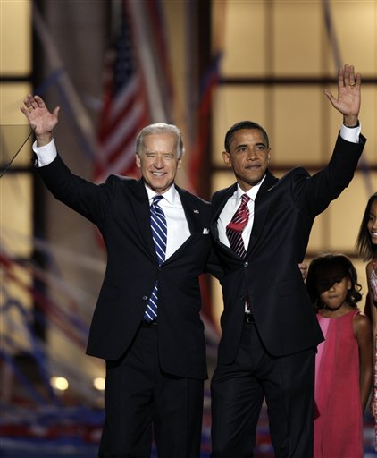ADVANCE FOR SUNDAY, AUG. 19 AND THEREAFTER - FILE - In this Aug. 28, 2008, file photo, Democratic presidential nominee, then-Sen. Barack Obama, D-Ill., and his running mate, then-Sen. Joe Biden, D-Del., wave after Obama's acceptance speech at the Democratic National Convention in Denver. Nearly four years after Barack Obama was elected to the most powerful office in the most powerful country in the world, the question remains: Who is he? This is a man who seemed to come out of nowhere. He had served seven years in the Illinois state Senate, and less than four years in the U.S. Senate _ a meager political resume, augmented by a stirring speech at the 2004 Democratic National Convention. (AP Photo/Ron Edmonds, File)