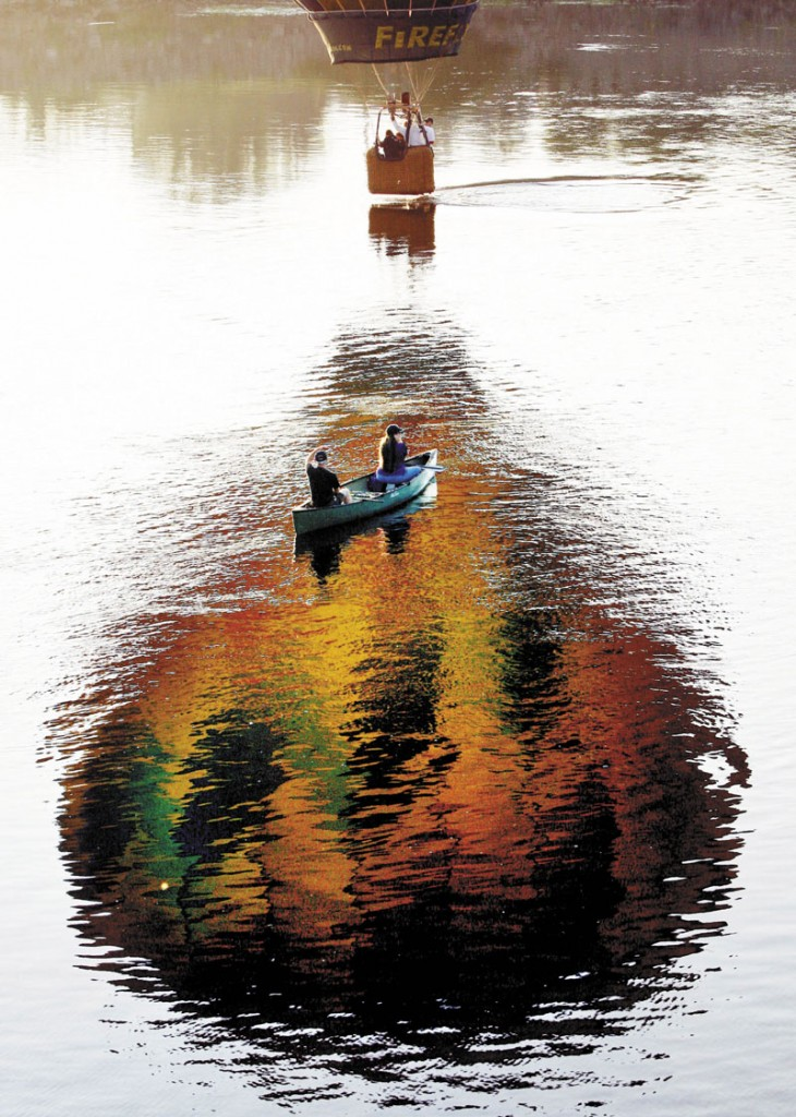A pilot dips the basket of his hot air balloon in the Androscoggin River in August 2011. The Riverwalk will soon offer visitors to Brunswick and Topsham close-up views of the river, as well as a scenic walk through the woods.
