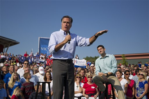 In this Aug. 25, 2012, photo, Republican presidential candidate, former Massachusetts Gov. Mitt Romney speaks as vice presidential running mate Rep. Paul Ryan, R-Wis., listens during a campaign rally in Powell, Ohio. Romney and Ryan are the political world�s newest odd couple. They�re bound by substance, but dramatically different in their styles. The running mates share a love of policy, and a fascination with the world�s economy and America�s place in it. But where Romney is buttoned-up and reserved on the campaign trail, Ryan is relaxed and exudes a natural enthusiasm. (AP Photo/Evan Vucci)