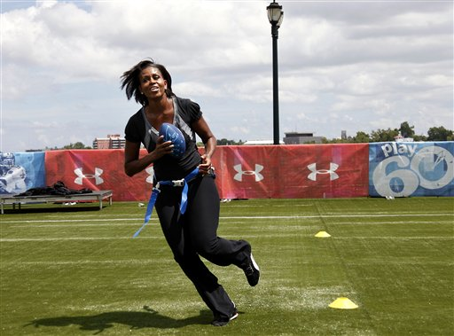 First lady Michelle Obama turns and runs after catching a pass while participating in the Let's Move! Campaign and the NFL's Play 60 Campaign festivities with area youth in New Orleans in this Sept. 8, 2010, photo.
