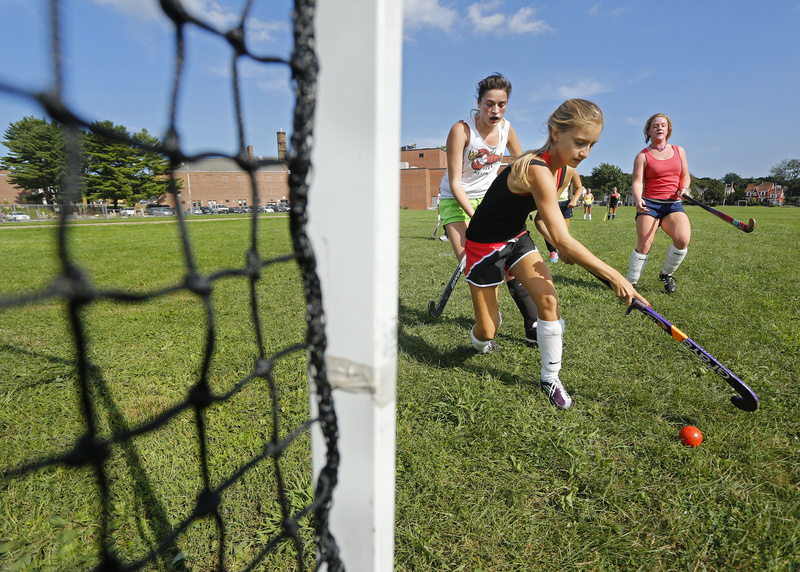 Amanda LeMoult prepares to take a shot as Deering teammate Carly Ladd gives chase. Also looking on is Kylie Patchell. The Rams start their season Aug. 30.