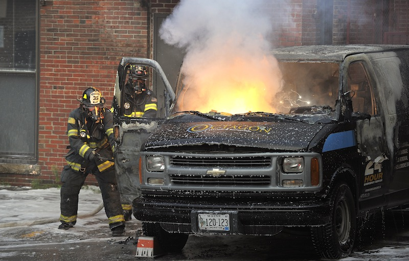 Firefighters responded to a van on fire in a parking lot off Exchange Street on Friday, August 17, 2012.