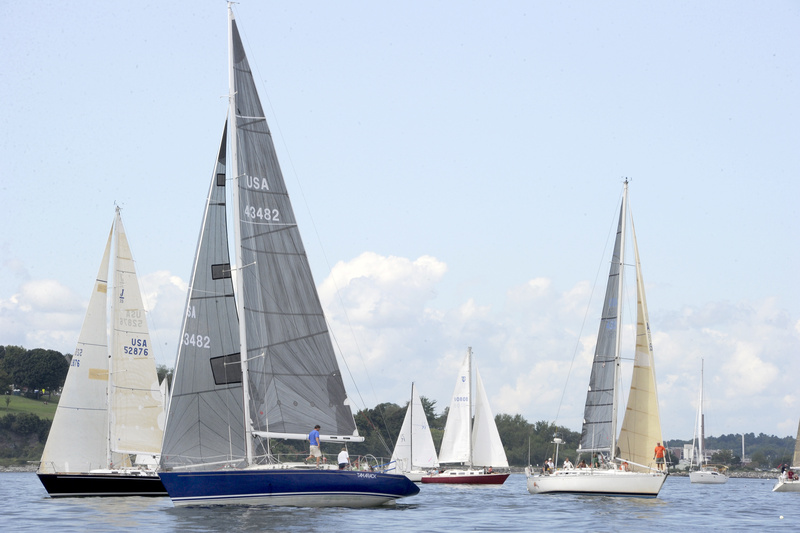 Sugar Sugar (black hull) and Family Wagon (blue hull) fight for position at the racing division 1 start during the 31st annaul MS Regatta in Portland Harbor on Saturday.