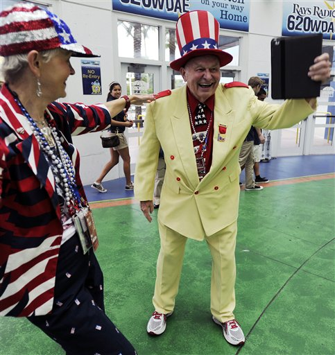 Col. Oscar Poole, right, and Claire Simpson, both of Georgia, arrive at the 2012 Tampa Bay Host Committee�s welcoming event for the delegates of the Republican National Convention on Sunday, Aug. 26, 2012 at Tropicana Field in St. Petersburg, Fla. (AP Photo/The Tampa Tribune, Chris Urso, Pool)