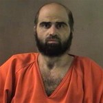 FILE - This undated file photo provided by the Bell County Sheriff's Department via The Temple Daily Telegram shows Nidal Hasan. The trial for the Army psychiatrist charged in the deadly 2009 Fort Hood shooting was put on hold Wednesday, Aug. 15, 2012, while an appeals court considers his objections to being forcibly shaved. (AP Photo/Bell County Sheriff's Department via The Temple Daily Telegram, File)