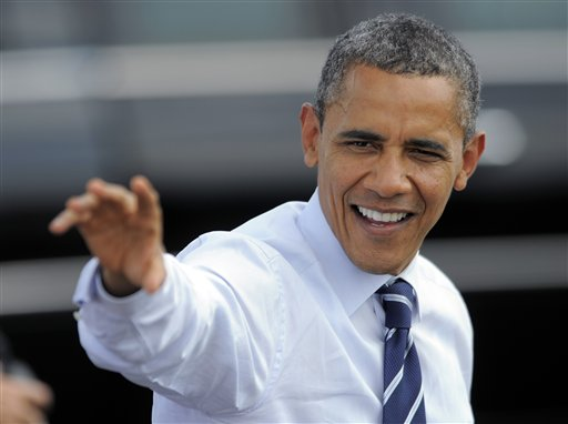 President Barack Obama waves to supporters as he arrives at Fort Collins-Loveland Municipal Airport, Tuesday, Aug. 28, 2012, in Loveland, Colo. (AP Photo/Jack Dempsey)