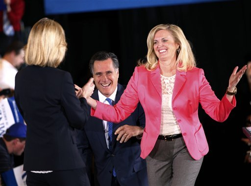 "FILE - In this March 6, 2012, file photo, Republican presidential candidate, former Massachusetts Gov. Mitt Romney, and his wife Ann arrive on stage as they are greeted by former Mass. Lt. Gov. Kerry Healey, at their Super Tuesday primary watch party in Boston. To the yearbook editors at the all-girl Kingswood School, Ann Lois Davies' destiny seemed pretty obvious. ""The first lady,"" the entry beside the stunning blond beauty's photo in the 1967 edition of ""Woodwinds"" concluded. ""Quiet and soft spoken."" The modern feminist movement was just dawning, and even some of the girls at the staid prep school in the wealthy Detroit suburb of Bloomfield Hills were feeling their oats _ if in a somewhat tame way. Charlon McMath Hibbard remembers getting a doctor's note about her feet, so she wouldn't have to wear the obligatory saddle Oxfords. (AP Photo/Gerald Herbert, File)"