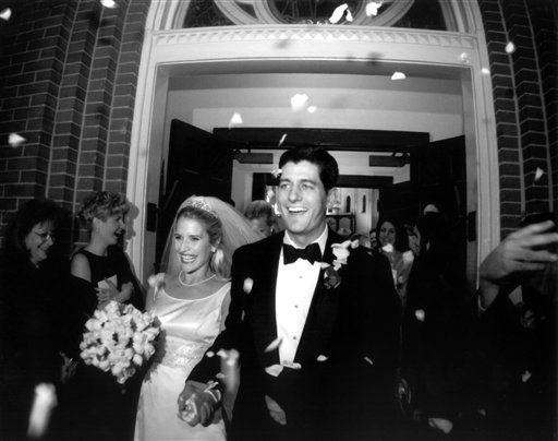 This undated photo provided by the Ryan family shows Paul Ryan and Janna Ryan on the day of their wedding. During his first term in Congress, Ryan met and married Janna Little, a lawyer and lobbyist from an affluent Oklahoma family, who was working in the Washington area. In the days since Republican presidential candidate, former Massachusetts Gov. Mitt Romney selected Ryan for the vice presidential slot on the Republican ticket, the now 42-year-old congressman's biography has become instant folklore. Lifelong resident of a little city in the heartland, embracing new responsibilities as a teen after the sudden death of his father. Devoted husband and father, devout Roman Catholic, avid deer hunter, fisherman and fitness buff. (AP Photo/Courtesy of the Ryan Family)
