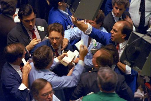 Traders on the floor of the New York Stock Exchange work frantically as panic selling swept Wall Street on Monday, Oct. 19, 1987. The Dow Jones industrial average plunged 508 points for the biggest one-day percentage decline in the history of the index.
