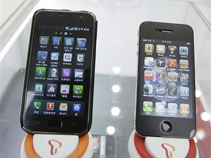 Samsung Electronics' Galaxy S, left, and Apple's iPhone 4 are displayed at a mobile phone shop in Seoul, South Korea. Apple Inc. filed a lawsuit against Samsung Electronics Co. last year alleging the world's largest technology company's smart phones and computer tablets are illegal knockoffs. Samsung countered that it's Apple that is doing the stealing and, besides, some of the technology at issue such as the rounded rectangular designs of smart phones have been industry standards for years.