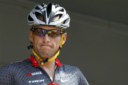 In this July 6, 2010, file photo, Lance Armstrong grimaces prior to the start of the third stage of the Tour de France cycling race in Wanze, Belgium. Armstrong said on Thursday, Aug. 23, 2012, that he is finished fighting charges from the United States Anti-Doping Agency that he used performance-enhancing drugs during his unprecedented cycling care