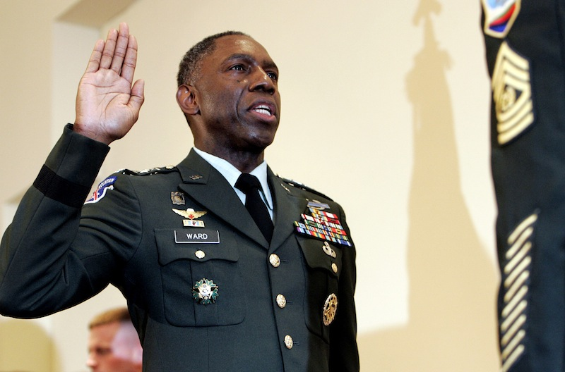 In this May 26, 2006 file photo, Army Lt. Gen. William E. Kip Ward is adminstered the oath of four-star General, the Army's highest rank of general, by Command Sgt. Major Mark Ripka, right, at Fort Myer, Va. The Associated Press has learned that Ward, who was the first head of the new U.S. Africa Command is under investigation and facing demotion for possibly spending hundreds of thousands of dollars improperly on lavish travel, hotels and other items. Several defense officials said Wednesday that Defense Secretary Leon Panetta is expected soon to decide the fate of Ward. (AP Photo/Caleb Jones, File)