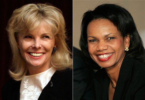South Carolina financier Darla Moore, left, and former U.S. Secretary of State Condoleeza Rice will become the first women in green jackets when Augusta National Golf Club opens for a new season in October.