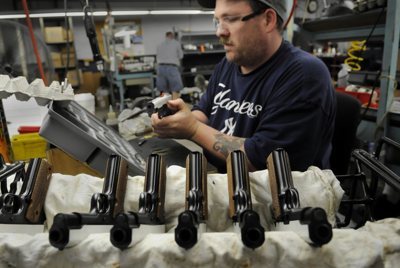 Al Cromwell of East Hampton, Conn., a Colt firearms assembler, works on the Colt 45 ACP model 1918. For the first time in three decades, a Colt .45-caliber pistol will be sold to the U.S. military for the Marines. 04000000 08000000 FIN HUM krtbusiness business krtcampus campus krtfeatures features krthumaninterest human interest krtnational national krtnews krtedonly mct 04018000 krtnamer north america krtusbusiness u.s. us united states 2012 krt2012