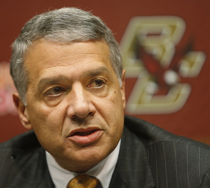 In this Jan. 7, 2009, file photo, Boston College athletic director Gene DeFilippo announces the firing of head football coach Jeff Jagodzinski during a news conference in Boston. DeFilippo took over the BC athletic department in 1997 in the wake of a gambling scandal and presided over its move from the Big East to the Atlantic Coast Conference announced on Friday, Aug. 17, 2012, that he is leaving, effective Sept. 30. (AP Photo/Stephan Savoia, File)