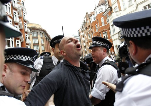 British police arrest protesters in support of WikiLeaks founder Julian Assange from the front of the Ecuadorian Embassy in central London today.