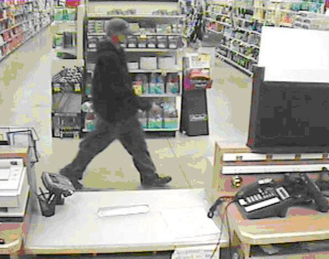 Store surveillance images of suspect in Osco pharmacy burglary.