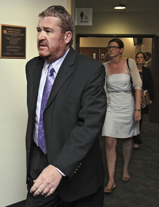Defense attorney Daniel King leads other public defenders into court for a motions hearing for suspected theater shooter James Holmes in district court in Centennial, Colo., on Thursday, Aug. 30, 2012. Holmes has been charged in the shooting at the Aurora theater on July 20 that killed twelve people and injured more than 50. (AP Photo/Barry Gutierrez)