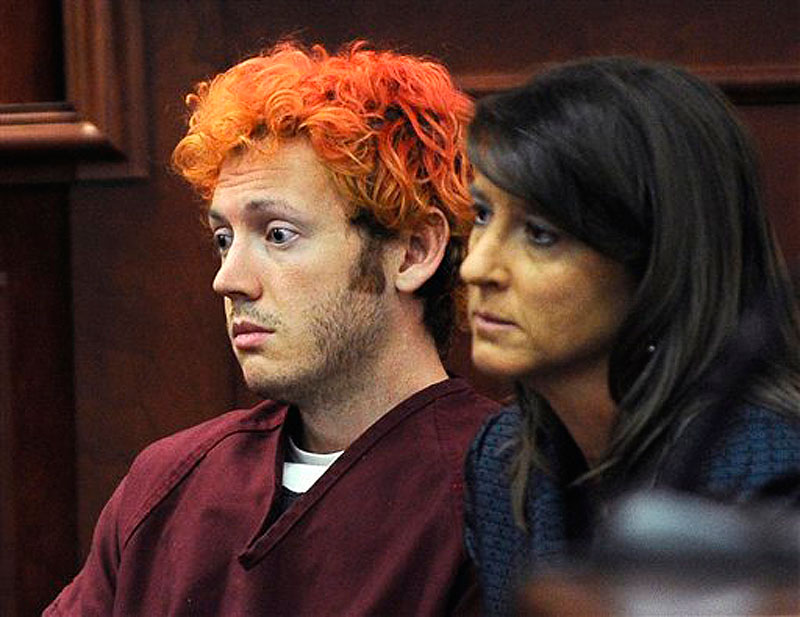 In this Monday, July 23, 2012 file photo, James Holmes, accused of killing 12 people in Friday's shooting rampage in an Aurora, Colo., movie theater, appears in Arapahoe County District Court with defense attorney Tamara Brady in Centennial, Colo. The prosecution is claiming Holmes made previous threats before the theater rampage. (AP Photo/Denver Post, RJ Sangosti, Pool, File)