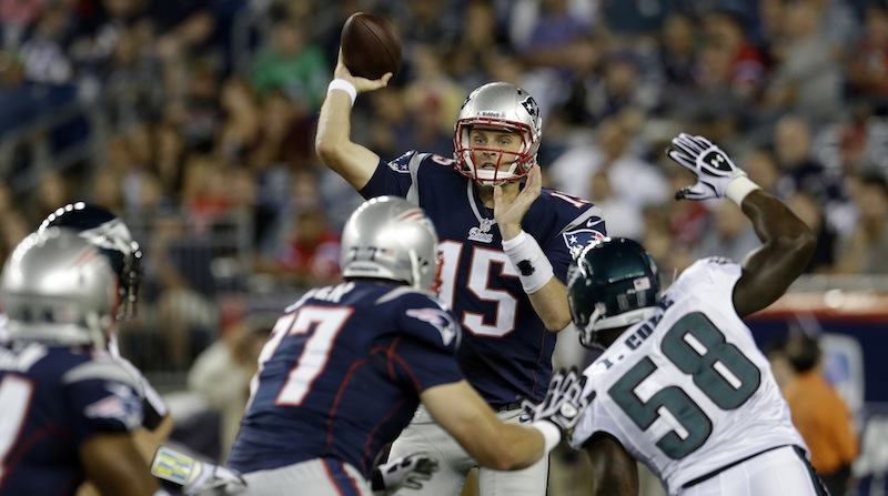 New England Patriots quarterback Ryan Mallett (15) throws as he is pressured by Philadelphia Eagles defensive end Trent Cole (58) during the first quarter of an NFL preseason football game in Foxborough, Mass., Monday, Aug. 20, 2012. (AP Photo/Elise Amendola)