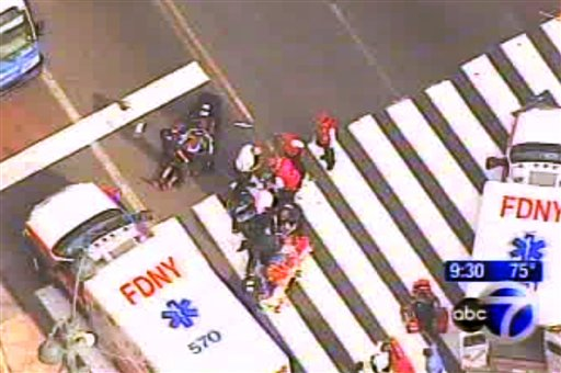 In this frame grab from WABC-TV, emergency personnel respond to reports of several people being shot outside the Empire State Building. Authorities say the shooter is dead.