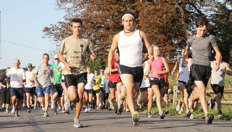 In this 2011 file photo, runners take off at the start of the Fourth Annual 5K Run for the Fallen. The event raises funds for military families who have lost a loved one, but the fifth and final one is Sunday because of feuding and a lawsuit.