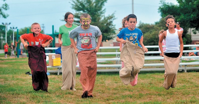 Children join in a sack race at the Family Fun Day hosted by Catholic Charities' Children's Case Management at North Street Park in Waterville on Saturday.