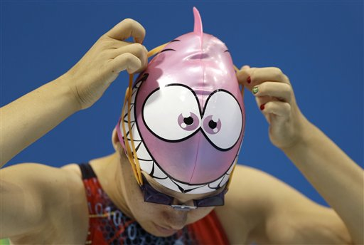 Jennet Saryyeva of Turkmenistan puts on her goggles during a practice session at the Aquatics Centre in the Olympic Park ahead of the 2012 Summer Olympics in London.