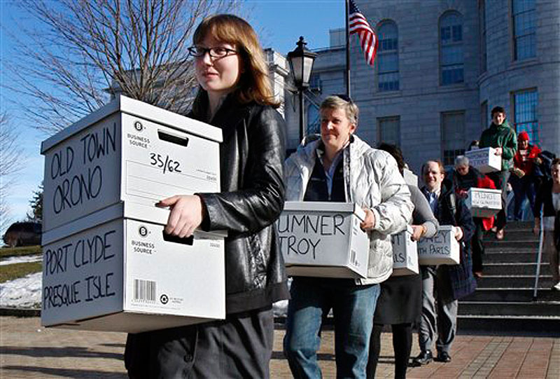 Whitney Gifford of Bucksport leads a group of gay marriage supporters carrying signed petitions to the Secretary of State's office in Augusta on Jan. 26, 2012. Maine voters will be the first in the nation to be asked to approve same-sex marriage by popular vote.