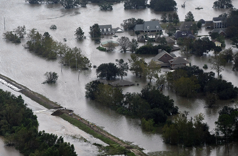 Aerial photo shows an intentional levy breach created to alleviate trapped floodwater in the community of Braithwaite, La., in the aftermath of Isaac on Thursday.