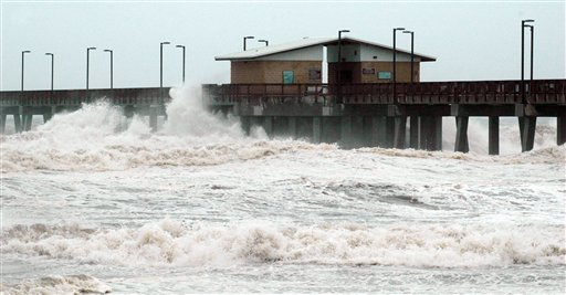 Waves crash into the public fishing pier at Gulf State Park in Gulf Shores, Ala., shortly before Hurricane Isaac made landfall in Louisiana on Tuesday. Crews removed flooring panels from the pier to prevent damage.