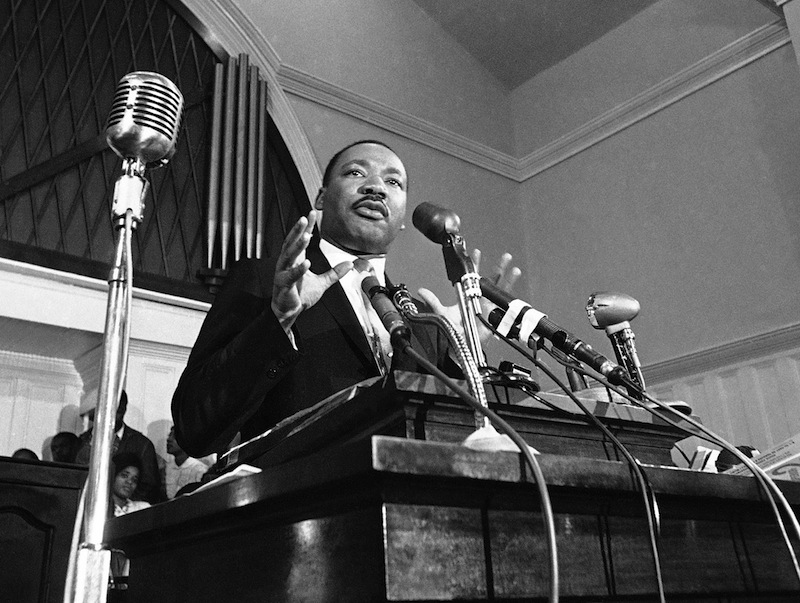 In this 1960 file photo, Martin Luther King Jr. speaks in Atlanta. A 1960 recording of an interview with King never before heard in public is up for sale. The tape was recorded by a Chattanooga man hoping to write a book and captures King talking about his trip to Africa, and his certainty that the child he and Coretta Scott King were expecting would be a boy. (AP File Photo) Microphone Communication Looking Away Standing Authority Gesturing