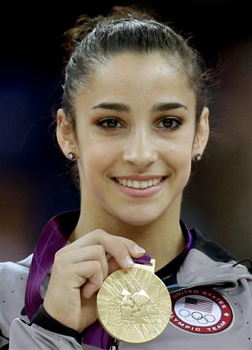 U.S. gymnast Aly Raisman displays her gold medal for the artistic gymnastics women's floor exercise final at the 2012 Summer Olympics in this Aug. 7, 2012, photo. 2012 London Olympic Games Summer Olympic games Olympic games Sports Events XXX Olympiad