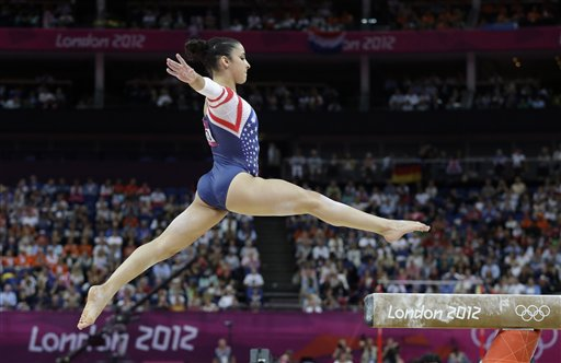 U.S. gymnast Alexandra Raisman jumps on the beam to start her exercise during the artistic gymnastics women's apparatus finals at the 2012 Summer Olympics, Tuesday, Aug. 7, 2012, in London. (AP Photo/Julie Jacobson) 2012 London Olympic Games Summer Olympic games Olympic games Sports Events XXX Olympiad