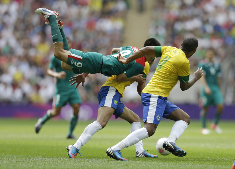 Mexico's Oribe Peralta goes airborne in front of Brazil's Juan Jesus, right, as they pursue the ball during the men's soccer final at the 2012 Summer Olympics on Saturday. 2012 London Olympic Games Summer Olympic games Olympic games Sports Events XXX Olympiad