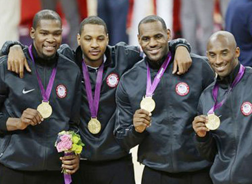 United States' Kevin Durant, Carmelo Anthony, LeBron James and Kobe Bryant, from left, display the gold medal following a ceremony at the 2012 Summer Olympics on Sunday in London.