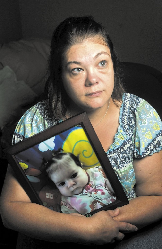 Nicole Greenaway holds a picture of her daughter, Brooklyn Foss-Greenaway, at her home in Clinton. Her 3-month-old baby died while in the care of a friend July 8.