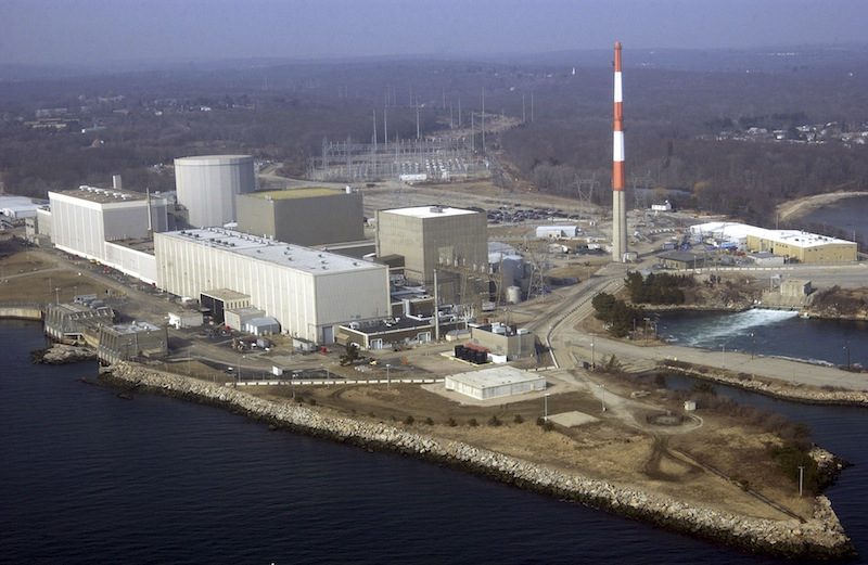 This March 18, 2003 aerial file photo shows the Millstone nuclear power facility in Waterford, Conn. Federal energy regulators said Monday, Aug. 13, 2012 that the nuclear power plant shut down one of two units Sunday because water from Long Island Sound used to operate the plant is too hot following the hottest July on record. (AP Photo/Steve Miller, File)
