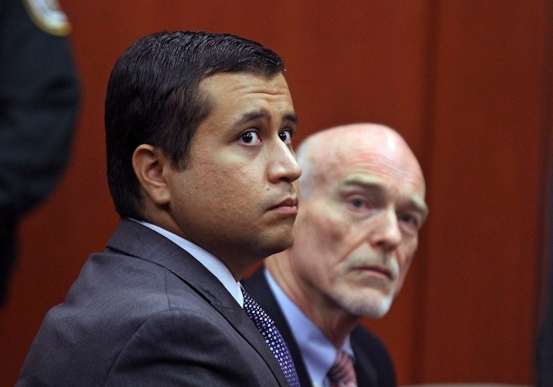 """In this June 29, 2012 file photo, George Zimmerman, left, and attorney Don West appear before Circuit Judge Kenneth R. Lester, Jr. Friday, June 29, 2012, during a bond hearing at the Seminole County Criminal Justice Center in Sanford, Fla. Zimmerman will try to have the murder charge dismissed under Florida's """"stand your ground"""" self-defense law, his attorney said Thursday, Aug. 9, 2012. Zimmerman is charged with second-degree murder in the shooting of Trayvon Martin. (AP Photo/Orlando Sentinel, Joe Burbank, Pool)"""
