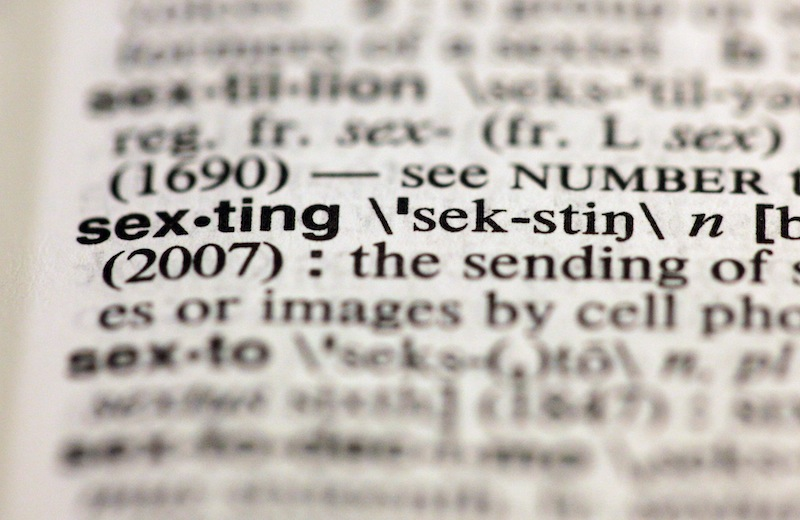 "The entry ""sexting,"" photographed in New York, Friday, Aug. 10, 2012, is one of the 15 new additions in the 11th edition of Merriam-Webster's Collegiate Dictionary. (AP Photo/Richard Drew)"