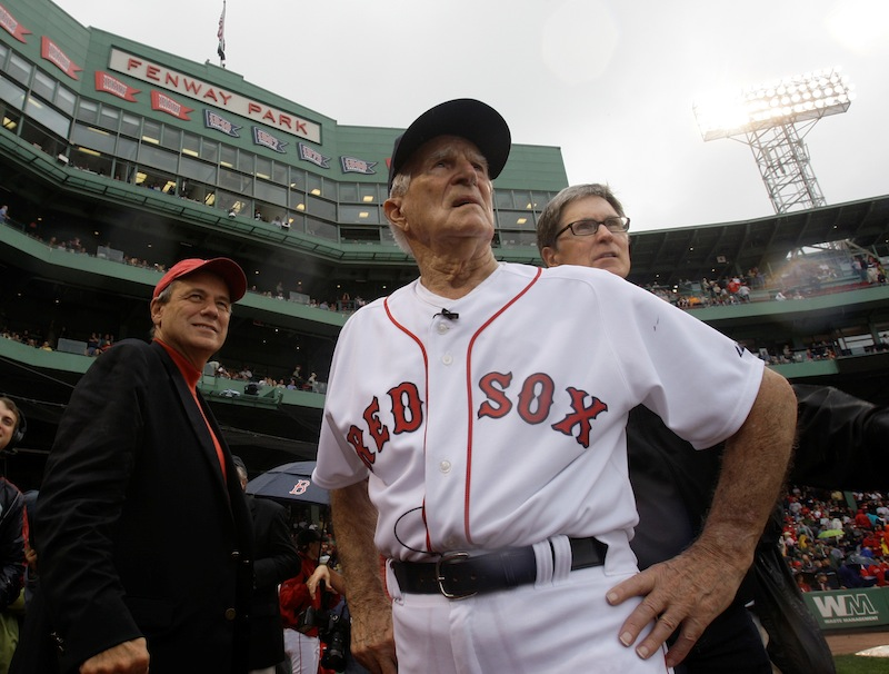 In this Sept. 28, 2008, file photo, Boston Red Sox great Johnny Pesky, center, is flanked by team president Larry Lucchino, left, and owner John Henry as they look past Pesky's Pole where Pesky's No. 6 adorns the upper deck during a ceremony to retire his number prior to a baseball game against the New York Yankees at Fenway Park in Boston. Pesky, who spent most of his 60-plus years in pro baseball with the Red Sox and was beloved by the team's fans, has died on Monday, Aug. 13, 2012, in Danvers, Mass. He was 92. (AP Photo/Charles Krupa, File)