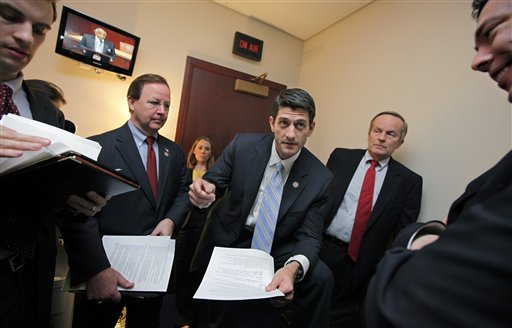 "House Budget Committee Chairman Paul Ryan, R-Wis., works with Republican members of the committee on Capitol Hill in April before introducing his controversial ""Path to Prosperity"" debt-reduction plan. He is flanked by Rep. Todd Akin, R-Mo., right, with Rep. Bill Flores, R-Texas, at left."