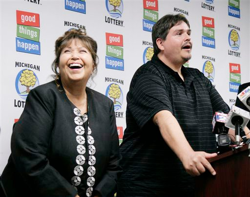 Donald Lawson, a 44-year-old Lapeer, Mich. resident, appears at a news conference Friday in which he claimed the $337 million Powerball prize. His mother, left, did not want to be identified.