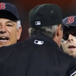 Boston Red Sox manager Bobby Valentine, left, and Boston's Dustin Pedroia, right, argue with first base umpire Paul Nauert in the ninth inning of a baseball game against the Texas Rangers in Boston on Tuesday. Pedroia was ejected. The Rangers won 6-3.