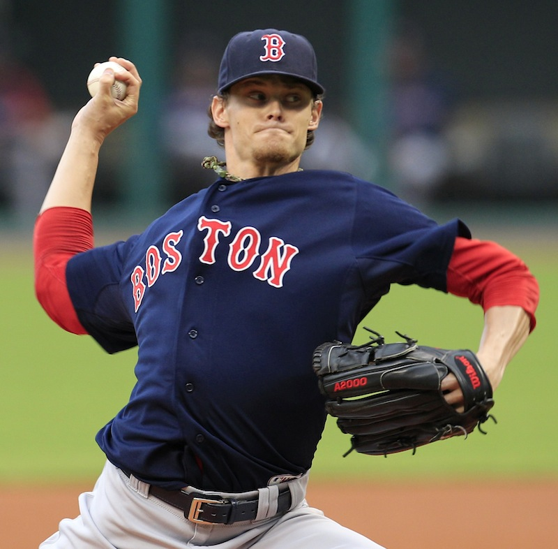 Boston Red Sox starter Clay Buchholz pitches in the first inning of a baseball game against the Cleveland Indians, Friday, Aug. 10, 2012, in Cleveland. (AP Photo/Tony Dejak)