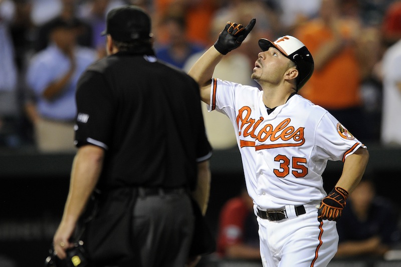 Baltimore Orioles' Omar Quintanilla (35) celebrates his home run against the Boston Red Sox during the third inning of a baseball game, Tuesday, Aug. 14, 2012, in Baltimore. (AP Photo/Nick Wass)