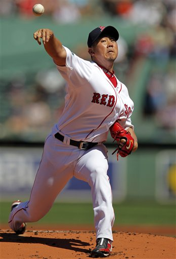 Boston Red Sox starting pitcher Daisuke Matsuzaka delivers a pitch against the Kansas City Royals in the first inning of a baseball game at Fenway Park, Monday, Aug. 27, 2012. (AP Photo/Steven Senne)