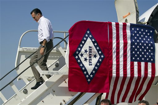Republican presidential candidate Mitt Romney arrives at Adams Field Airport for a fundraising event on Wednesday in Little Rock, Ark.