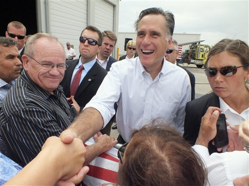 Republican presidential candidate Mitt Romney shakes hands during a campaign event at Watson Truck and Supply on Thursday in Hobbs, N.M.